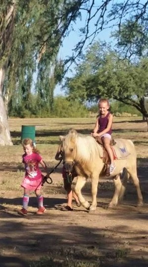 Girls love to ride a pony