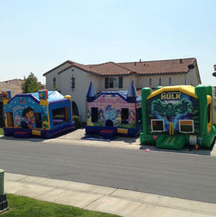 Inflatable Bouncers in Front Yard