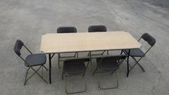 6 foot adult table with 6 brown adult chairs (renter to setup)