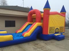 USED COMBO 5 IN 1 BOUNCE HOUSE WITH WATERSLIDE, BASKETBALL HOOP, AND OBSTACLE PILLARS - FOR SALE