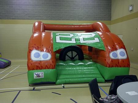 Grand Prix bouncy castle entrance showing steering wheel pop up