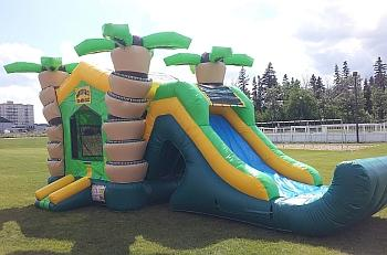 Tropical bouncy castle with slide