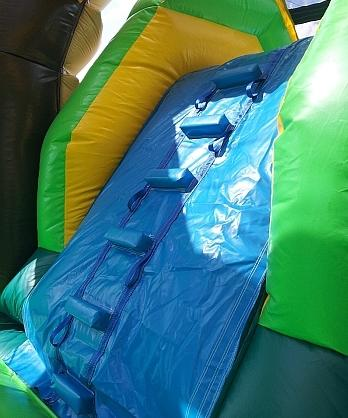 Steps to the big slide on our Tropical bouncy castle