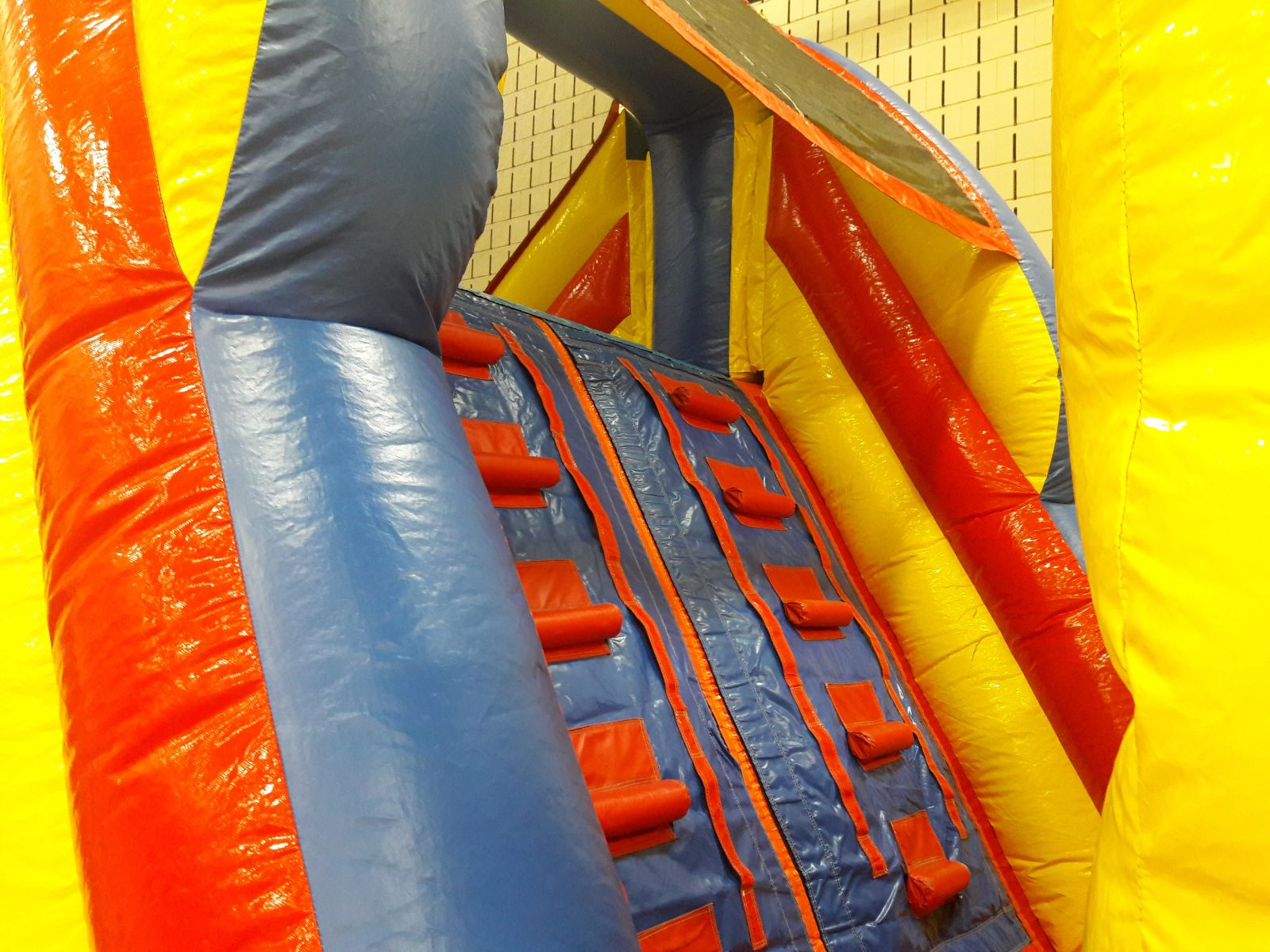 Climbing wall to top of the 13 foot slide on obstacle course