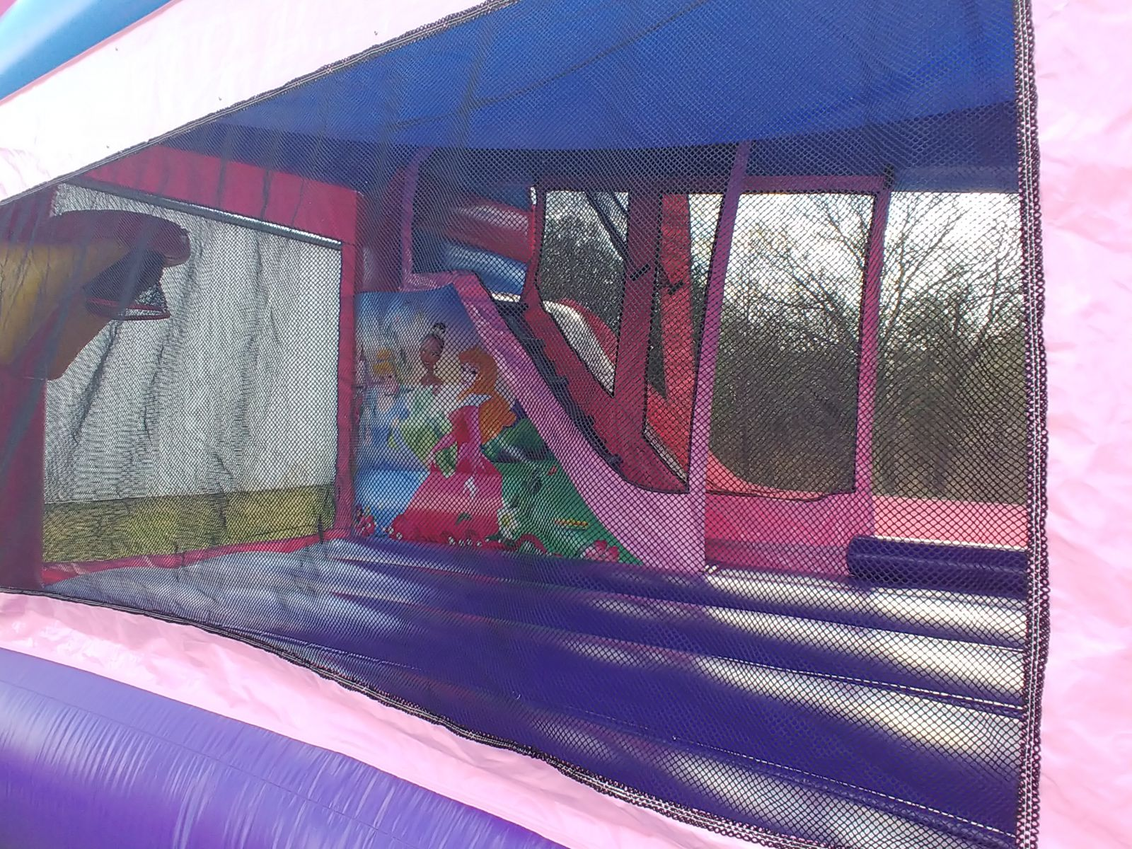 Disney Princess Combo interior view with basketball hoop and climbing wall with slide bounce house