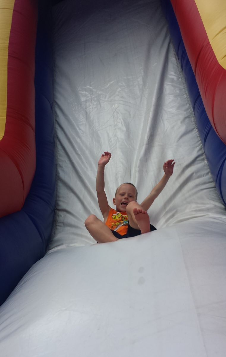 Giant inflatable slide with child going down