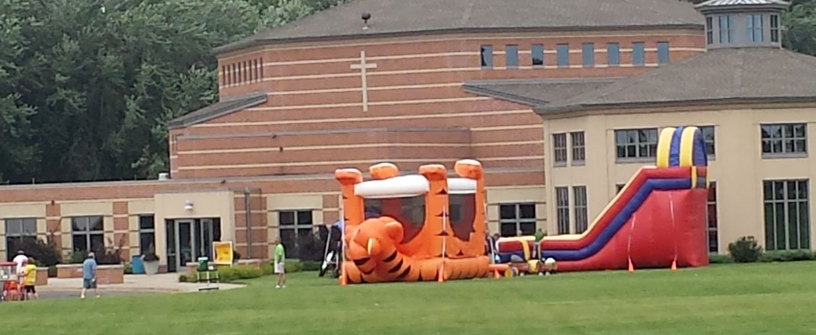 Tiger Belly Bouncer and 18' GIANT Dry Slide in front of church