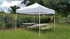 Tent 10 x 10 with two picnic tables or two tables and 20 chairs