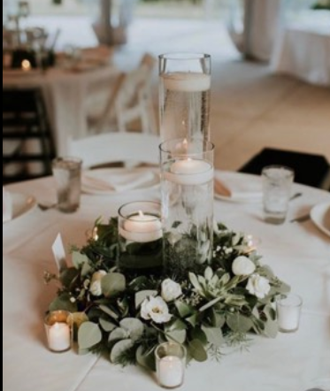 Arrangement #1 includes the following Three vases different sizes  floating real candles 4 votives with real candles real greenary, 4 baby flowers  * The only items we don't need back is the real greenery and baby flowers*
