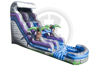 Angled view of the water slide exterior. Shaped in a wave theme with a two palm trees in the middle of the slide.