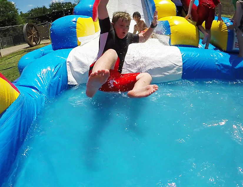 Boy sliding down waterslide