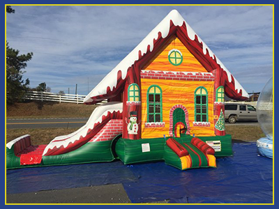 Slight angled view of the Christmas Cabin Combo Water Slide.