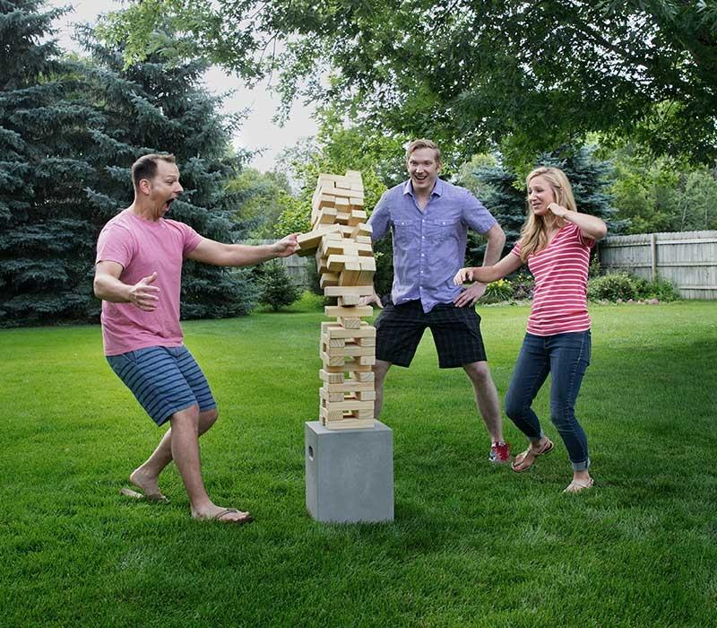 People playing giant Jenga in outdoor