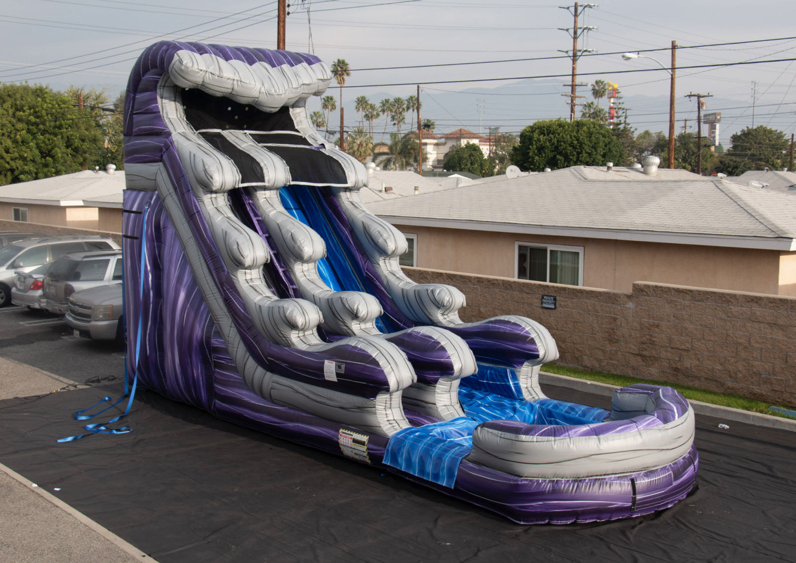 18' foot water slide with pool attached shaded in grey, blue, and midnight purple.