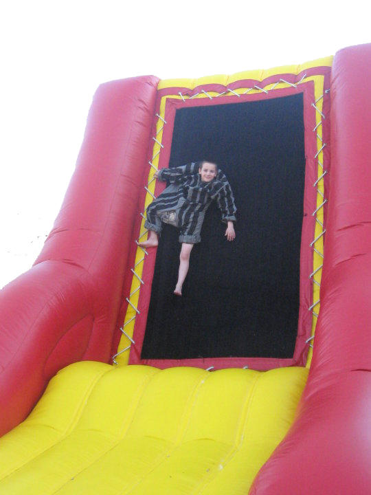 Little boy sticking to the Velcro Wall