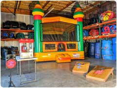 Party Package BIncludes: 14x14 bounce house, concession machine with supplies, game and a portable Bluetooth speaker.