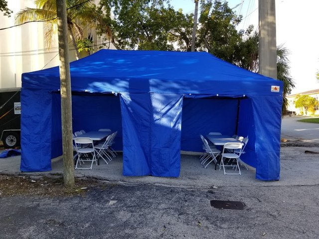10x20 Blue tent with walls 3 tables and 30 chairs
