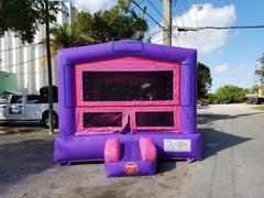 Purple and pink bounce house with hoop