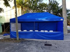 10x20 Blue Vender Tent with 6 tables and 12 chairs