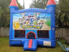 Blue castle bounce house with hoop in side