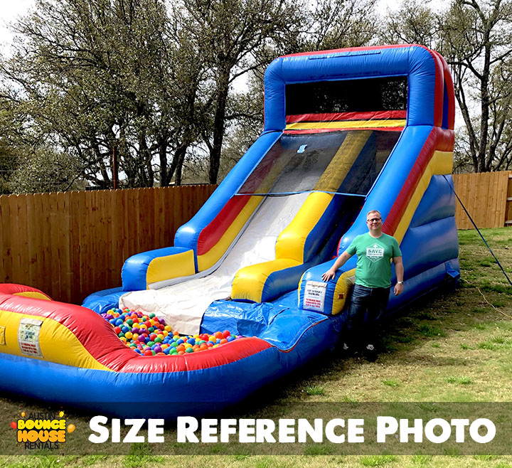 Man Standing Next to Slide'n Play with Ball Pit Rental item from Austin Bounce House Rentals in Austin Texas