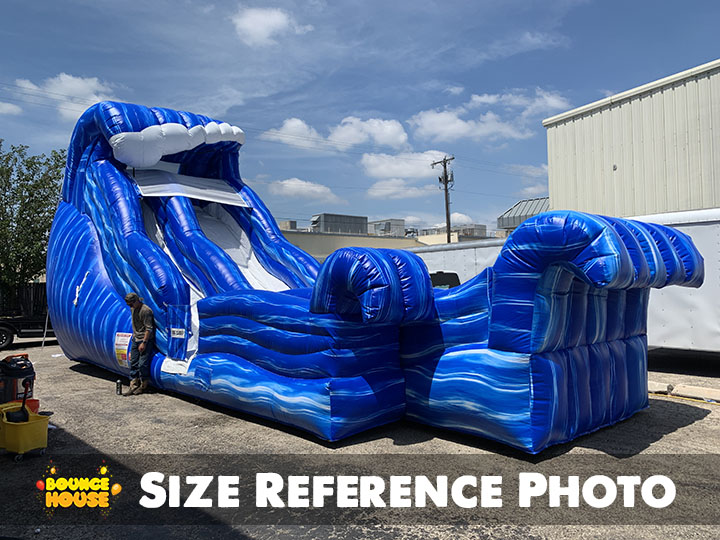 Man next to Wild Wave Water Slide rental in Austin Texas from Austin Bounce House Rentals