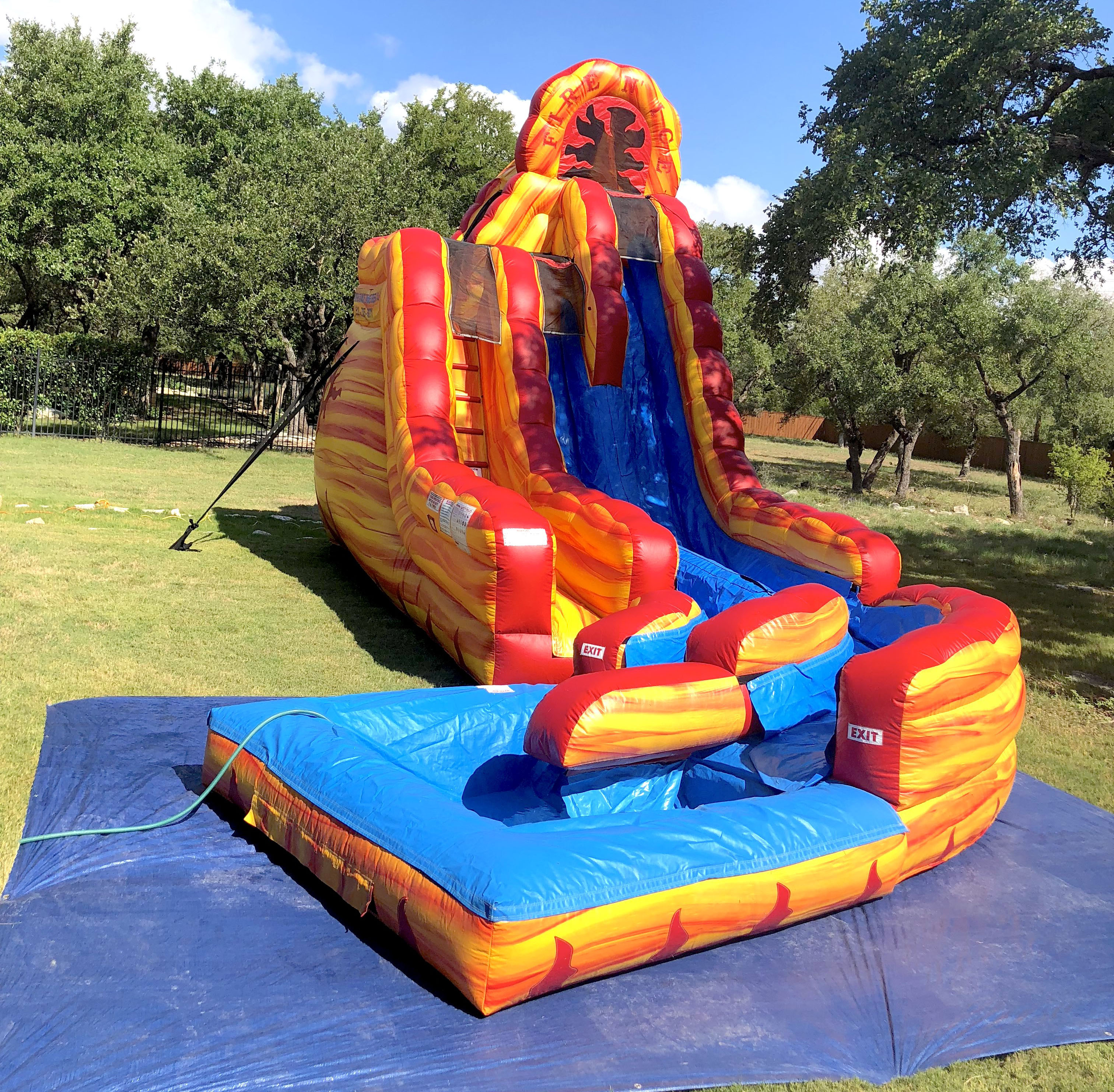 Super Water Slide setup in backyard on grass