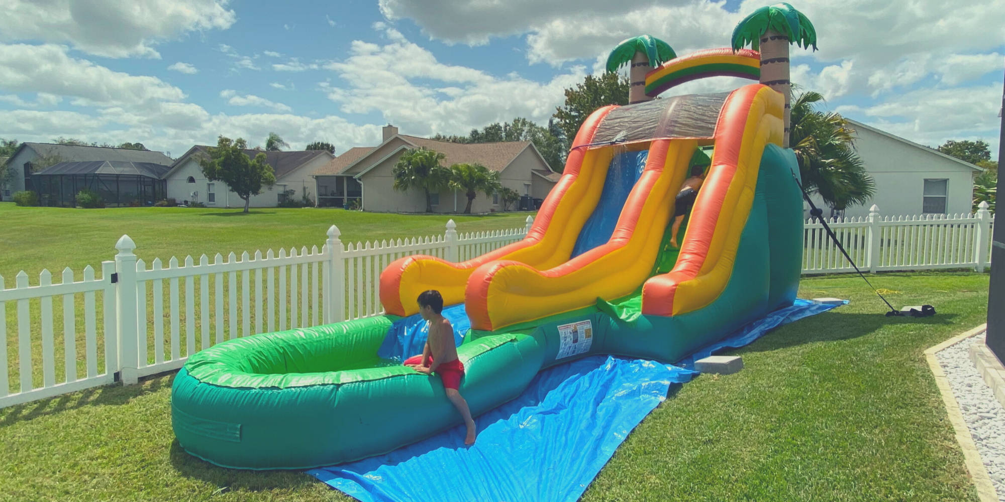 Children playing in the 15 feet tropical water slide