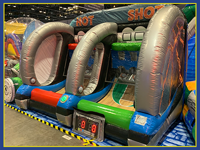 Angled view of the Hot Shot Inflatable with basketball wall design and clear subdivider.