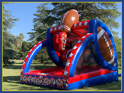 Side view of the All American football themed bouncy inflatable.