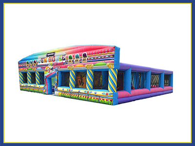 Angled view of the fun house maze. Colorful blend of secondary and primary color with a carnival theme design.