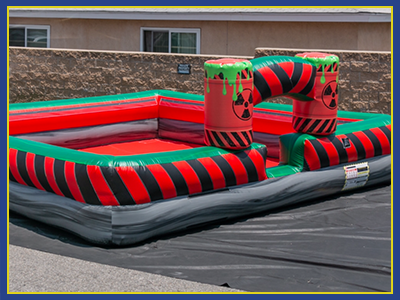 angled view of the red toxic themed foam pit with forest green trim.