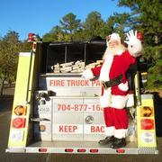 Santa visits on a Fire Truck