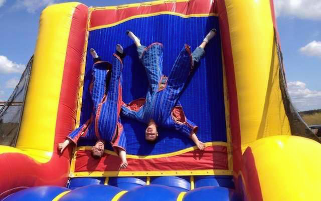 Kids stuck to the inflatable velcro wall
