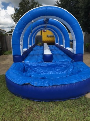 A Double Lane Slip N Slide With Pool