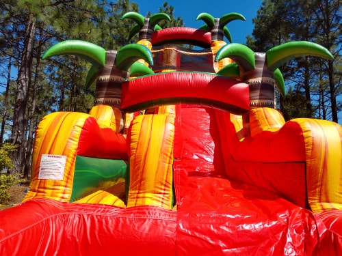 Rent the Tropical Fiesta 22 foot tall water slide from Carolina Fun Factory for your next event