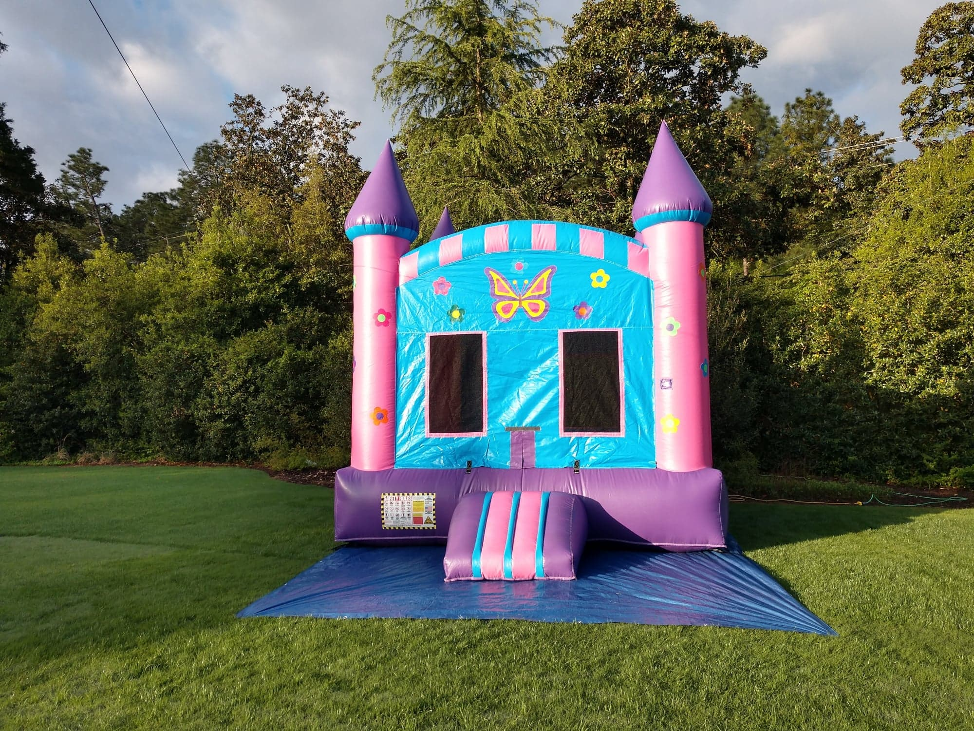 Pink and Purple Bounce House with Butterfly