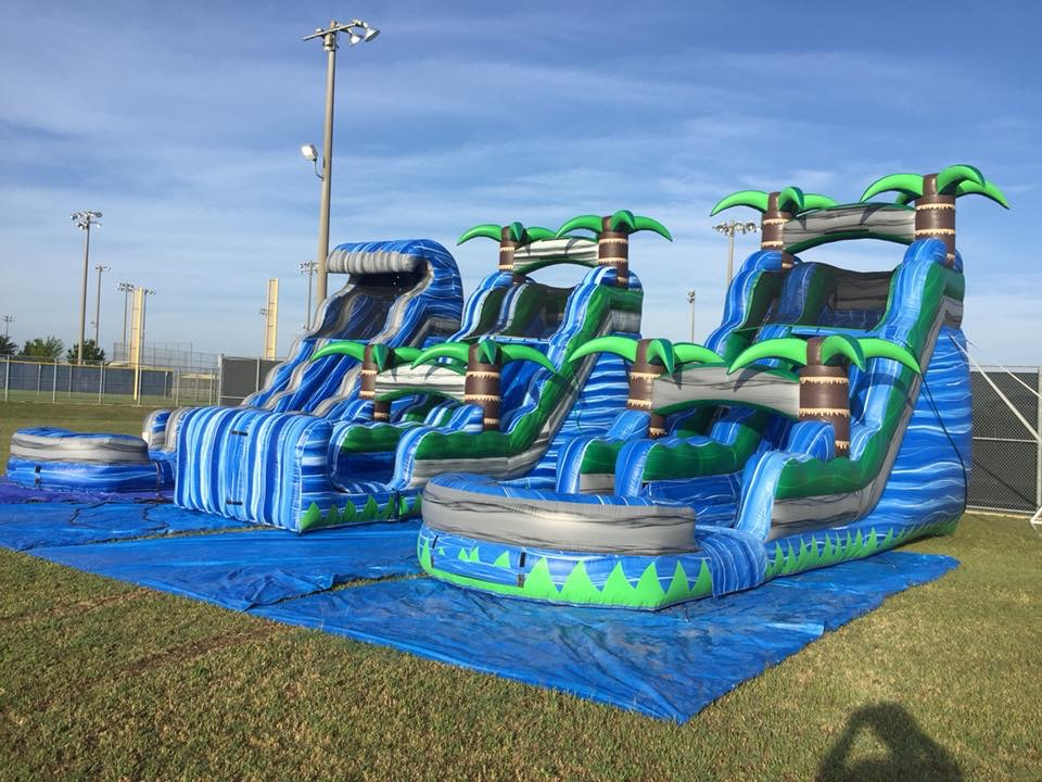 large water slides at a school field day