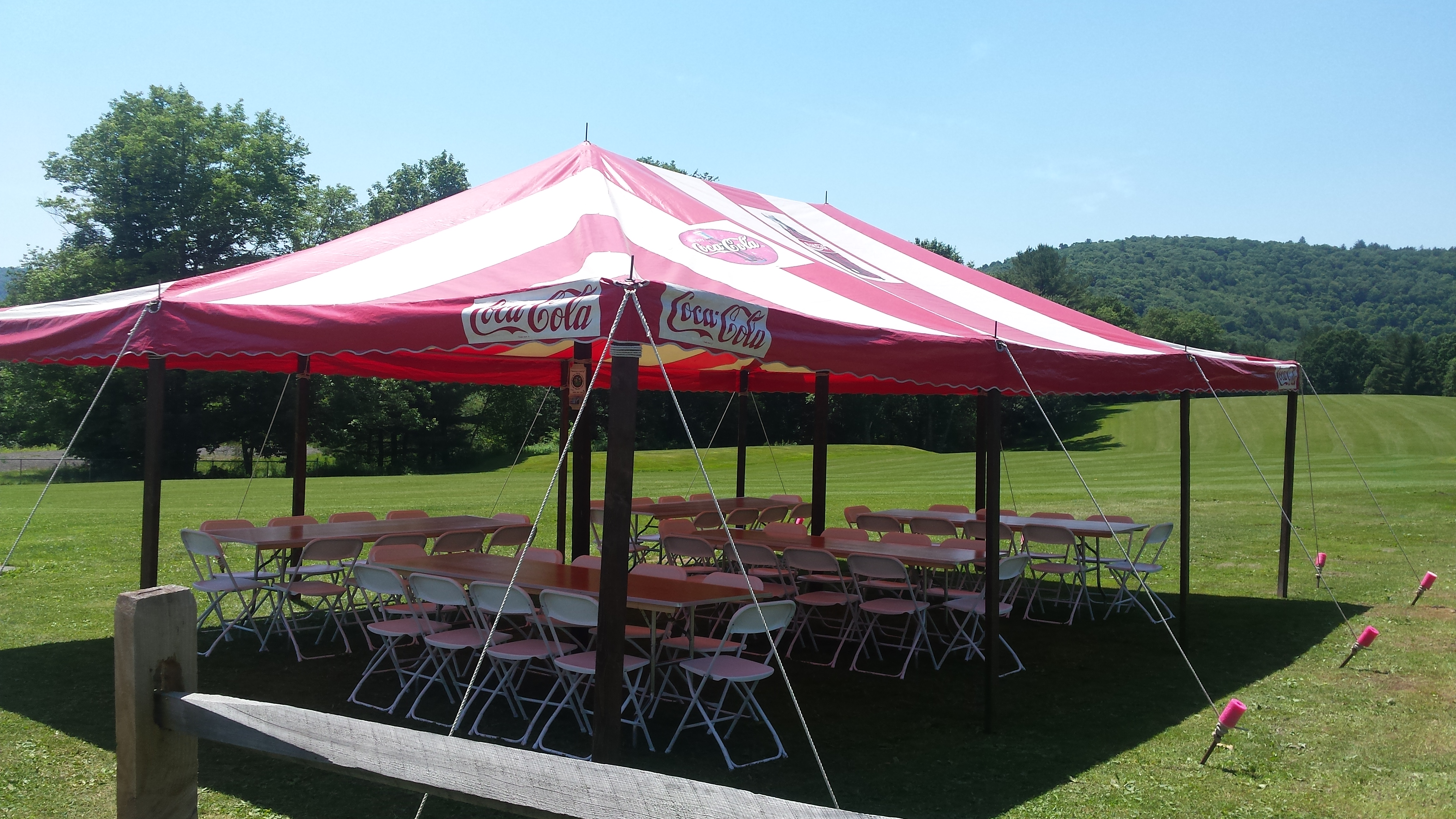 Party tent set-up with tables and chairs underneath