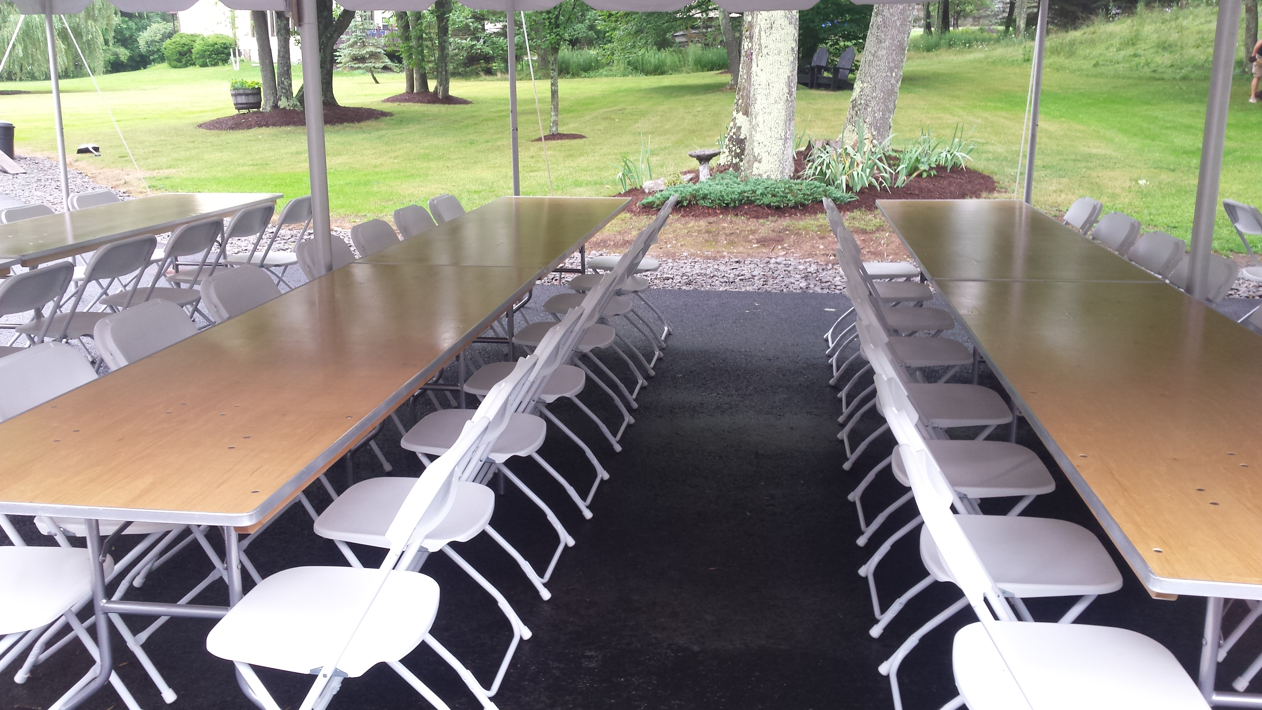 Tables with chairs under tent