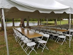White 20 x 20 Pole Tent with Banquet Tables & White Chairs