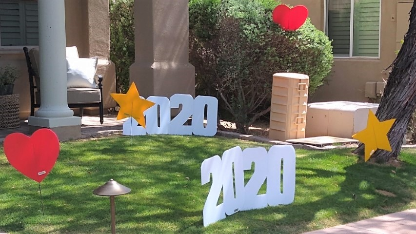 yard display for graduation of stars, hearts and 2020s