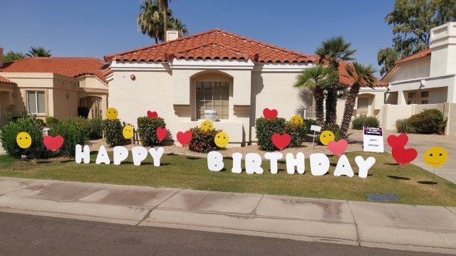 big white Happy Birthday letter with hearts & smileys yard card