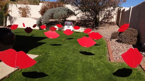 Fathers Day lawn display of giant red lips