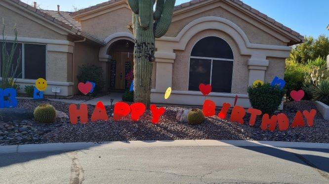 big orange Happy Birthday letters with 13s hearts & smileys