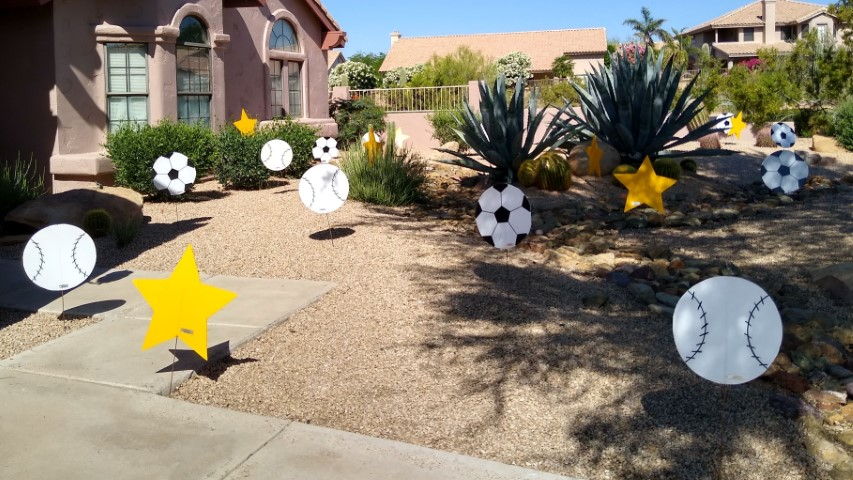 stars, baseballs, soccer balls in Dad's yard for Father's Day