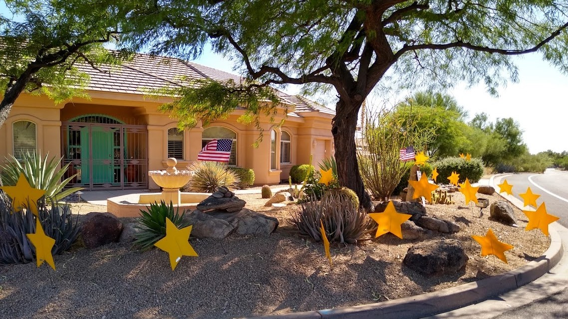 stars and flags in yard for July 4th