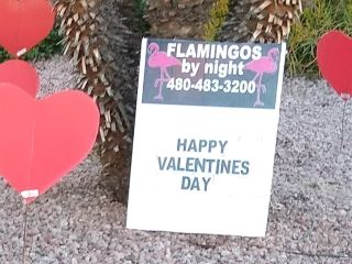 happy Valentine's Day yard sign with big red hearts