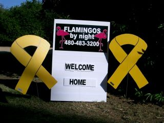 welsome home yard sign with yellow ribbons