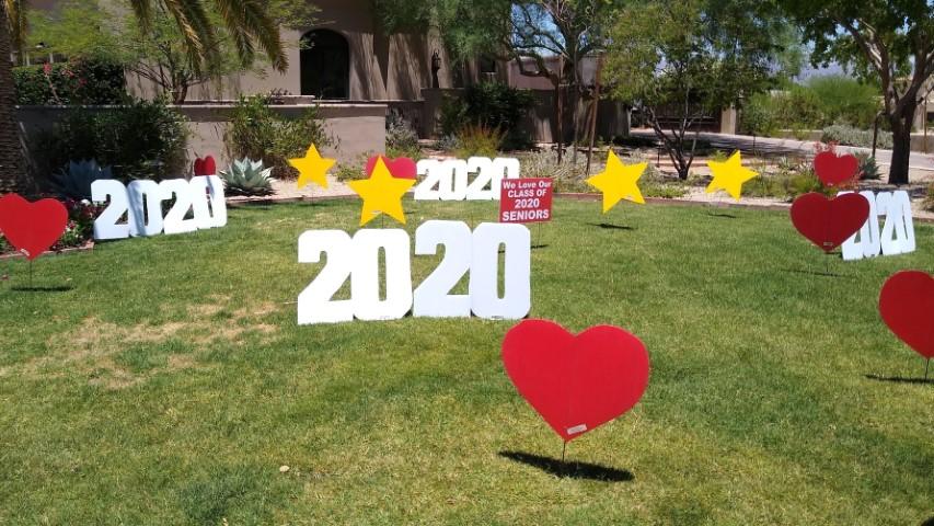 2020 graduation yard display with hearts and stars